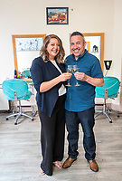 """Pictured: Richard Davies (R) and  Faye Stevenson who won the £1 EuroMillions in Talgarth near Brecon, Wales, UK.<br /> Re: A Brecon hairdresser whose car broke down on his way to claim his £1 million EuroMillions UK Millionaire Maker prize, has bought AA membership as one of his first post-win purchases.<br /> Time was also of the essence when winner Richard Davies, who has owned Chop and Change salon in Talgarth for 14 years, dashed out to buy his EuroMillions ticket with just four minutes to spare before the draw closed on Friday, 1 June. <br /> And now after 10 years as a couple, he and partner Faye Stevenson are planning on splashing out on their first holiday together, after matching one of that night's EuroMillions UK Millionaire Maker codes to scoop the life-changing amount. <br /> Nurse Faye, and Richard, 41, both have hectic work schedules. He said: """"I had forgotten to buy my ticket and, as ever, Friday had been frantic in the salon!"""