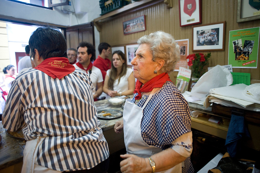 Elizabeth-Fernandez family grandmother Paulina, 90 years old, works at the Churreria La Mañueta on July 9, 2013, in Iruña-Pamplona, Basque Country. The churreria Mañueta exists since December 13, 1872. Five generations of the family Elizabeth-Fernández has worked on the Mañueta churrería since 1872. During San Fermin Festival is an old tradition to eat 'churros' in the morning before and after the running of the bulls. Mañueta opens its doors for the last two Saturdays of June, the festival of San Fermin and all Sundays in October. (Ander Gillenea / Bostok Photo)