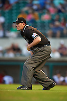 Umpire Scott Costello watches a play during a game between the Corpus Christi Hooks and Arkansas Travelers on May 29, 2015 at Dickey-Stephens Park in Little Rock, Arkansas.  Corpus Christi defeated Arkansas 4-0 in a rain shortened game.  (Mike Janes/Four Seam Images)