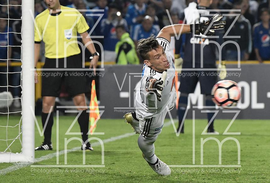 BOGOTA - COLOMBIA -08 -02-2017: Nikolas Vikonis, arquero de Millonarios, en acción durante la definición por tiros penal en el partido entre Millonarios de Colombia y Atletico Paranaense de Brasil, por la segunda fase, llave 1 de la Copa Conmebol Libertadores Bridgestone 2017 jugado en el estadio Nemesio Camacho El Campin, de la ciudad de Bogota. / Nikolas Vikonis, goalkeeper of Millonarios, during the definition by the penalty series in a match between Millonarios of Colombia and Atletico Paranaense of Brasil, for the second phase, key1, of the Conmebol Copa Libertadores Bridgestone 2017 played at Nemesio Camacho El Campin in Bogota city. Photo: VizzorImage / Gabriel Aponte / Staff.