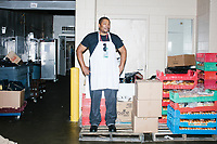 A catering worker stands on a palette in a backstage area at the Democratic National Convention at the Wells Fargo Center in Philadelphia, Pennsylvania, on Wed., July 27, 2016.