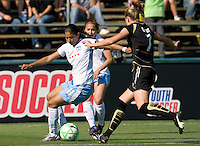 07 June 2009:  Cristiane of the Red Stars dribbles the ball away from Leigh Ann Robinson of the Gold Pride during the game at Buck Shaw Stadium in Santa Clara, California.   FC Gold Pride tied Chicago Red Stars, 1-1.