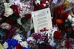 A poem and flowers lying outside the stadium before the 25th anniversary memorial service to the 1989 Hillsborough disaster at Liverpool Football Club's Anfield Stadium. The Hillsborough stadium disaster led to 96 Liverpool football fans losing their lives in a crush at an FA Cup semi final tie against Nottingham Forest. The families of the victims campaigned against the original verdict of the incident and were rewarded with a new inquiry held in 2014 into events at the match at Hillsborough. Photo by Colin McPherson.