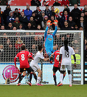 SWANSEA, WALES - FEBRUARY 21: Goalkeeper Lukasz Fabianski of Swansea catches the ball from a Manchester cross during the Barclays Premier League match between Swansea City and Manchester United at Liberty Stadium on February 21, 2015 in Swansea, Wales.