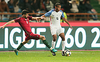 Leiria, Portugal - Tuesday November 14, 2017: Luís Neto, Tyler Adams during an International friendly match between the United States (USA) and Portugal (POR) at Estádio Dr. Magalhães Pessoa.