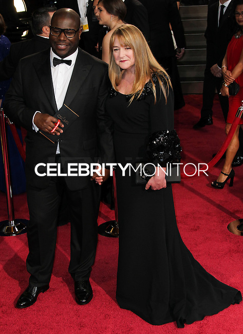 HOLLYWOOD, LOS ANGELES, CA, USA - MARCH 02: Steve McQueen, Bianca Stigter at the 86th Annual Academy Awards held at Dolby Theatre on March 2, 2014 in Hollywood, Los Angeles, California, United States. (Photo by Xavier Collin/Celebrity Monitor)