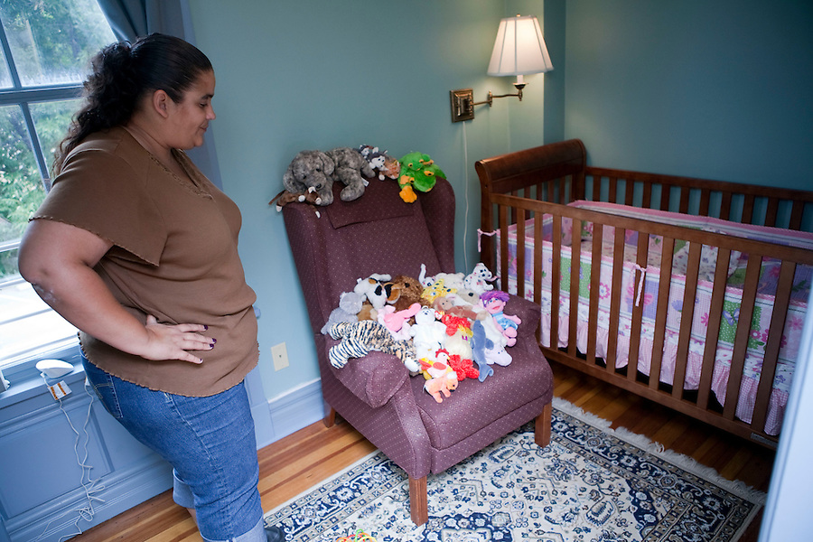 """""""I have six children and five TPR's (Terminated Parental Rights)...I'm not a model mother,"""" Brandi said.  As a resident of The Mother-Child Reunification House program at Amos House in Providence, Rhode island, she prepares for the first unsupervised overnight visit she will have with her infant daughter, Patience. Brandi is one of a group of women taking part in a new program which is using a different approach to reuniting mothers with their children.  The program combines life skill training, counseling and treatment in a safe and supportive longterm residential home.  For Brandi, this is a chance to change her life and gain custody of her youngest child, the only one not taken permanently by Rhode Island State Child Protective Service. <br /> """"A lot of my past (behavior) has to do with the  children I lost.  I have six children, but I do not have any of my children.  I can't see the other ones (those given to adoption).  I do not know where they are.  She's the only one that I have,"""" Brandy said."""