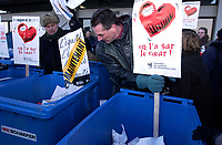 February 28, 2002, Montreal, Quebec, Canada; <br /> <br /> Montreal's teachers protest the proposed Government reform of salary equity.<br /> <br /> Following Quebec city teachers pressure tactics, the deonstrators toss the reform's formation program documents in recycly bins, February 28th, 2002 in front of the Quebec Education Minister office in Montreal (Qc) Canada.<br /> <br /> (Mandatory Credit: Photo by Sevy - Images Distribution (©) Copyright 2002 by Sevy<br /> <br /> NOTE :  D-1 H original JPEG, saved as Adobe 1998 RGB