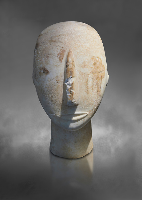 Head of a Cycladic statue with remnants of painted eyes and right cheek, Parian Marble, Amorgos, Early Cycladic II period (2800-3200BC). National Archaeological Museum, Athens.   Gray background.