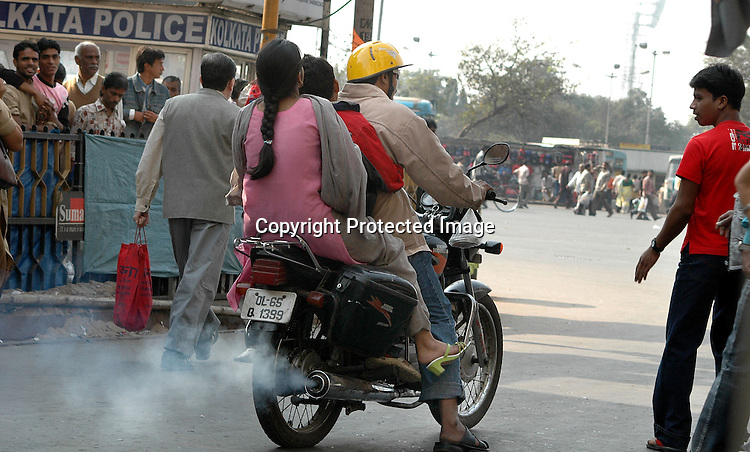 INDIA (West Bengal - Calcutta)  2007,A motor cycle  emitting white smoke. Awarness is less among the people about polluting vehicle and people dont care to go for an emiission test . A recent report by CNIC (CHITTARANJAN NATIONALCANCER INSTITUTE)  one of the most prominent cancer Institue of the country declairs Calcutta has the most air pollution in the country and 70% of its population suffers from respiratory and lung diseases. - Arindam Mukherjee