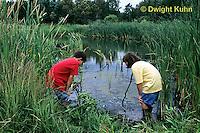 FA27-141z  Children exploring at pond