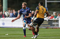 Mark Bright (Captain) of London Scottish passes under pressure from Andrew Durutalo of Ealing Trailfinders during the Greene King IPA Championship match between London Scottish Football Club and Ealing Trailfinders at Richmond Athletic Ground, Richmond, United Kingdom on 8 September 2018. Photo by David Horn.