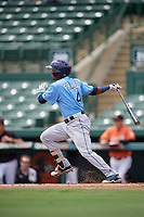 Tampa Bay Rays Wander Franco (4) follows through on a swing during an Instructional League game against the Baltimore Orioles on October 2, 2017 at Ed Smith Stadium in Sarasota, Florida.  (Mike Janes/Four Seam Images)