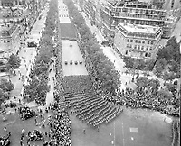 Parisians line the Champ Elysees to cheer the massed infantry units of the American army as they march in review towards the Arc de Triomphe, celebrating the liberation of the capital of France from Nazi occupation.  August 29, 1944.  Parker.  (Army)<br /> NARA FILE #:  111-SC-193997<br /> WAR & CONFLICT BOOK #:  1060