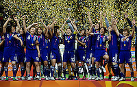 Homare Sawa, trophy, Japanese team.  Japan won the FIFA Women's World Cup on penalty kicks after tying the United States, 2-2, in extra time at FIFA Women's World Cup Stadium in Frankfurt Germany.