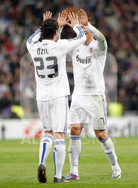 Madrid (16/03/2011).- Estadio Santiago Bernabeu..UEFA Champion League..Real Madrid 3 - Olympique Lyonnais 0.Ozil y Cristiano Ronaldo celebran un gol...©Alex Cid-Fuentes/ALFAQUI...