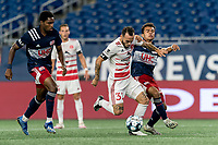 FOXBOROUGH, MA - AUGUST 21: Emiliano Terzaghi #32 of Richmond Kickers on the attack as Colby Quinones #41 of New England Revolution II  defends during a game between Richmond Kickers and New England Revolution II at Gillette Stadium on August 21, 2020 in Foxborough, Massachusetts.