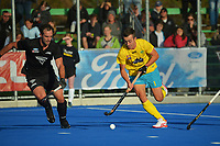 NZ's Dane Lett and Australia's Lachland Sharp in action during the Sentinel Homes Trans Tasman Series hockey match between the New Zealand Black Sticks Men and the Australian Kookaburras at Massey University Hockey Turf in Palmerston North, New Zealand on Sunday, 30 May 2021. Photo: Dave Lintott / lintottphoto.co.nz