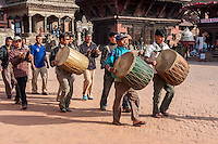 Bhaktapur, Nepal.  Men with Drums and Cymbals marching through Durbar Square.