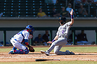 Salt River Rafters first baseman Tyler Nevin (2), of the Colorado Rockies organization, slides safely into home plate ahead of catcher Jhonny Pereda (6) during an Arizona Fall League game against the Mesa Solar Sox at Sloan Park on October 30, 2018 in Mesa, Arizona. Salt River defeated Mesa 14-4 . (Zachary Lucy/Four Seam Images)