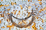 Drugs in sugar bowl with spoon.  Legal prescription drugs represented with sugar bowl and spoon.  Conceptual image representing drug culture, medical, insurance, dichotomy, and more. Available exclusively through www.spacesimages.com