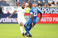 KANSASCITY, KS - JULY 11: Junior Hoilett #10 of Canada .Sebastien Cretinoir #21 of Martinique during a game between Canada and Martinique at Children's Mercy Park on July 11, 2021 in KansasCity, Kansas.