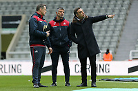 (L-R) Goalkeeping coach Tony Roberts with coach Joao Mario and Swansea manager Carlos Carvalhal stand on the pitch prior to the game during the Premier League match between Newcastle United and Swansea City at St James' Park, Newcastle, England, UK. Saturday 13 January 2018