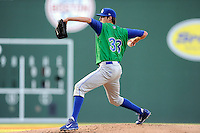 Starting pitcher Luke Farrell (33) of the Lexington Legends throws in a game against the Greenville Drive on Thursday, April 24, 2014, at Fluor Field at the West End in Greenville, South Carolina. Greenville won, 9-4. (Tom Priddy/Four Seam Images)
