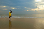 Tourist filming the sunset at Benaulim Beach. Benaulim Beach, Goa, India.