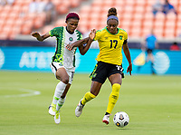 HOUSTON, TX - JUNE 10: Rasheedat Ajibade #15 of Nigeria is defended by Allyson Swaby #17 of Jamaica during a game between Nigeria and Jamaica at BBVA Stadium on June 10, 2021 in Houston, Texas.