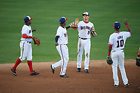 Potomac Nationals Telmito Agustin (4), Victor Robles (16), Rhett Wiseman (9), and Edwin Lora (10) celebrate after closing out the first game of a doubleheader against the Salem Red Sox on May 13, 2017 at G. Richard Pfitzner Stadium in Woodbridge, Virginia.  Potomac defeated Salem 6-0.  (Mike Janes/Four Seam Images)