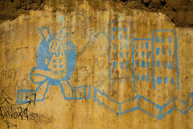 Close-up of faded art on concrete walls in Leon, Nicaragua