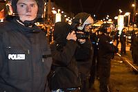 Ca. 90 Hooligans und Nazis beteiligten sich am Montag den 1. Februar 2016 im Berliner Stadtteil Prenzlauer Berg an einer NPD-Demonstration gegen Asyl und Fluechtlinge. Die aggressive Demonstration wurde von lautstarken Protesten mehrerer hundert Gegendemonstranten begleitet. Die Demonstrationsroute wurde auf Anweisung der Polizei um 2/3 gekuerzt.<br /> Im Bild: Ein sog. Anti-Antifa-Fotograf steht in einer Polizeikette und fotografiert Gegendemonstranten.<br /> 1.2.2016, Berlin<br /> Copyright: Christian-Ditsch.de<br /> [Inhaltsveraendernde Manipulation des Fotos nur nach ausdruecklicher Genehmigung des Fotografen. Vereinbarungen ueber Abtretung von Persoenlichkeitsrechten/Model Release der abgebildeten Person/Personen liegen nicht vor. NO MODEL RELEASE! Nur fuer Redaktionelle Zwecke. Don't publish without copyright Christian-Ditsch.de, Veroeffentlichung nur mit Fotografennennung, sowie gegen Honorar, MwSt. und Beleg. Konto: I N G - D i B a, IBAN DE58500105175400192269, BIC INGDDEFFXXX, Kontakt: post@christian-ditsch.de<br /> Bei der Bearbeitung der Dateiinformationen darf die Urheberkennzeichnung in den EXIF- und  IPTC-Daten nicht entfernt werden, diese sind in digitalen Medien nach §95c UrhG rechtlich geschuetzt. Der Urhebervermerk wird gemaess §13 UrhG verlangt.]
