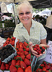 Linda Marrone shows off some of the berries at the Rodriquez Ranch, of Watsonville, Ca., booth at the 3rd & Curry St. Farmers Market in downtown Carson City, Nev. on Sept. 11, 2010..Photo by Cathleen Allison/NevadaPhotoSource.com