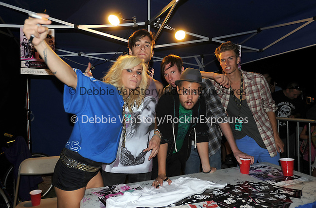 The Sounds sign autograph for fans at Verizon Wireless Ampitheatre in Irvine, California on August 04,2009                                                                   Copyright 2009 DVS / RockinExposures