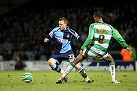 Scott Davies of Wycombe Wanderers, former Reading player and Republic of Ireland U21International takes the ball past Yeovil's Keiran Murtagh during Yeovil Town vs Wycombe Wanderers, Coca Cola League Division One Football at Huish Park on 26th December 2009