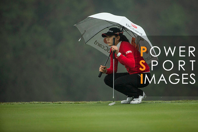 Jung Min Lee of South Korea plays at the 18th hole during Round 4 of the World Ladies Championship 2016 on 13 March 2016 at Mission Hills Olazabal Golf Course in Dongguan, China. Photo by Victor Fraile / Power Sport Images