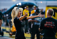 Aug 31, 2018; Clermont, IN, USA; Alice Bode, wife of NHRA funny car driver Bob Bode celebrates with crew members during qualifying for the US Nationals at Lucas Oil Raceway. Mandatory Credit: Mark J. Rebilas-USA TODAY Sports