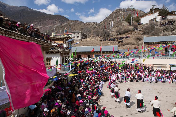 East Village, Diqing Tibetan Autonomous Prefecture, Yunnan Province, China - Tibetan villagers watch traditional Xianzi Dance, February 2017.