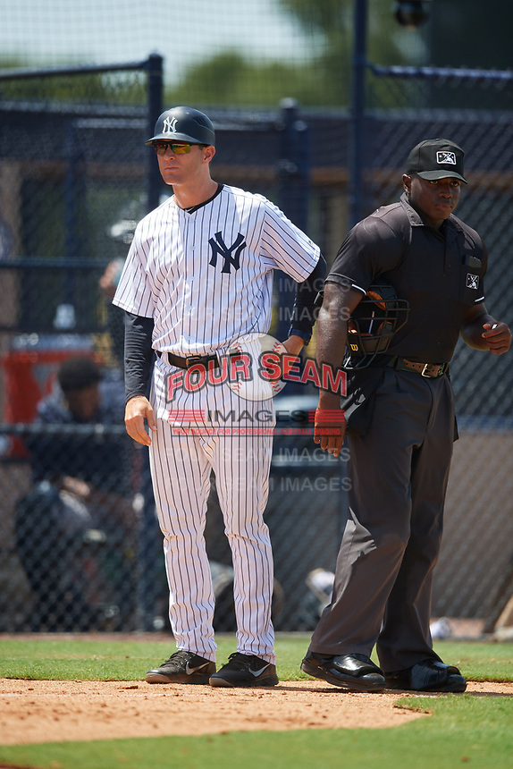 GCL Yankees West manager David Adams and home plate umpire Tre Jester during a game against the GCL Yankees East on August 8, 2018 at Yankee Complex in Tampa, Florida.  GCL Yankees West defeated GCL Yankees East 8-4.  (Mike Janes/Four Seam Images)