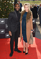 Ore Oduba and wife, Portia<br /> arriving for the TRIC Christmas Party, Grosvenor House Hotel, London.<br /> <br /> <br /> ©Ash Knotek  D3362  12/12/2017