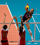 22 August 2010, Hong Kong, China ---  Jordan Larson of the USA spikes the ball against China during their volleyball game on the last day of the FIVB World Grand Prix Pool G at the Hong Kong Coliseum stadium. Photo by Victor Fraile --- Image by © Victor Fraile