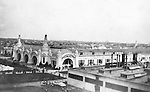 St Louis MO:  View of the Palace of Transportation from the Ferris Wheel at the Louisiana Purchase Exposition.  The Palace of Transportation featured all the forms of travel past, present, and future; stagecoach, Locomotives, automobiles, and airplanes