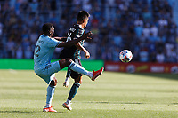 ST PAUL, MN - AUGUST 14: Bakaye Dibassy #12 of Minnesota United FC and Efraín Alvarez #26 of the Los Angeles Galaxy battle for the ball during a game between Los Angeles Galaxy and Minnesota United FC at Allianz Field on August 14, 2021 in St Paul, Minnesota.