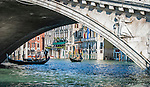 Under the Rialto Bridge in Venice, Italy