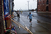 Brooklyn, New York<br /> August 28, 2011<br /> <br /> Brooklyn the morning after (hurricane) tropical storm Irene past over New York. <br /> <br /> Flood streets in Red Hook as people come out to see the damage. A wind tunnel races from the Hudson Bay into Red Hook.<br /> <br /> A child runs to take the wind and fly down the street.