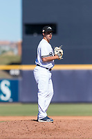 Peoria Javelinas relief pitcher Daniel Brown (49), of the Milwaukee Brewers organization, gets ready to deliver a pitch during an Arizona Fall League game against the Scottsdale Scorpions at Peoria Sports Complex on October 18, 2018 in Peoria, Arizona. Scottsdale defeated Peoria 8-0. (Zachary Lucy/Four Seam Images)