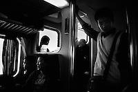 Travelers leave Shanghai, China, by train.