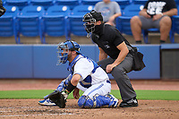 Umpire Casey James and Dunedin Blue Jays catcher Ryan Sloniger (24) during a game against the Bradenton Marauders on June 5, 2021 at TD Ballpark in Dunedin, Florida.  (Mike Janes/Four Seam Images)