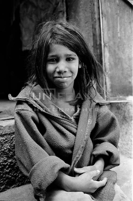 Young girl hanging around in the streets of Jaipur, Rajastan.<br /> Jaipur, India, 2012